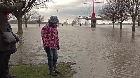söğüt : Duisburg  Germany - January 08 2017 : Tourists surprised by the river Rhine flooding the promenade