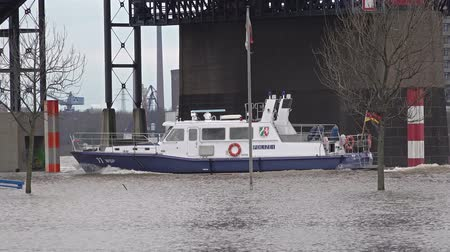 vodoznak : Duisburg  Germany - January 08 2017 : Police vessel passing the flooded promenade