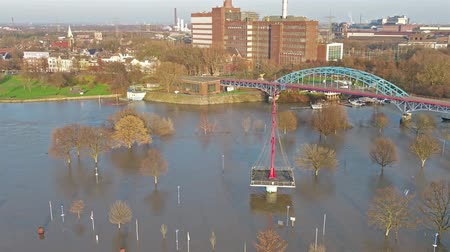 vodoznak : Duisburg  Germany - January 08 2017 : The Muehlenweide is flooded by the river Rhine - aerial view