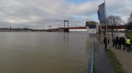 handrails : Duisburg  Germany - January 08 2017 : The flooding watermark in Ruhrort is climbing from 9.24 meters up to 9.68 meters
