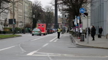 kíséret : Munich  Germany - February 16 2018 : Convoy of politicians passing on their way to the Munich Security Conference