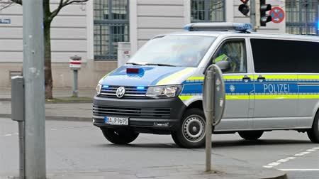 kíséret : Munich  Germany - February 16 2018 : Huge amount of police controlling the streets of Munich and taking care to guide all politicians to the Munich Security Conference