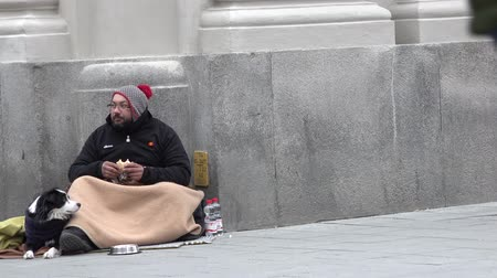 belongings : Munich  Germany - February 15 2018 : Homeless man eating doner kebap in the streets