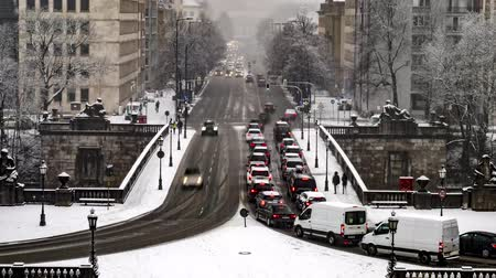 herceg : Munich  Germany - February 17 2018 : Traffic is driving through the snow during the snow storm - Aerial Time lapse