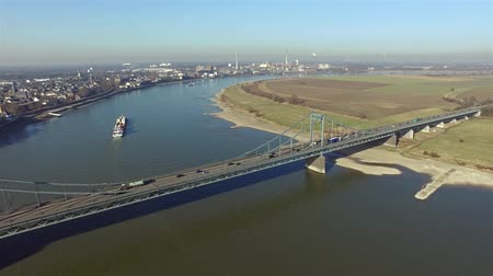 harbor bridge : Krefeld  Germany - February 15, 2017 : Container ship passing the bridge between Krefeld and Duisburg Stock Footage