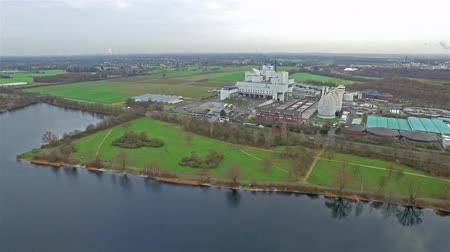 azaltmak : Krefeld  Germany - December 30 2015 : Aerial view of the Elfrather sea and garbage incineration plant Stok Video