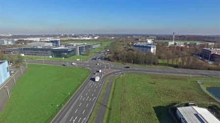 canon : Krefeld  Germany - February 22 2016 : Aerial view of the street crossing Oberschlesien street and Anrather street with the industrial area Fichtenhain in the background Stock Footage