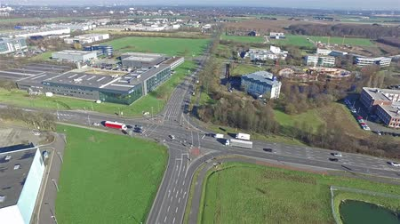 légi felvétel : Krefeld  Germany - February 22 2016 : Aerial view of the street crossing Oberschlesien street and Anrather street with the industrial area Fichtenhain in the background Stock mozgókép