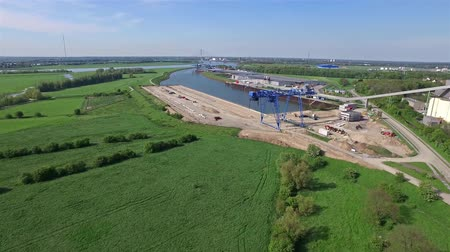 demolição : VOERDE  GERMANY - MAY 06 2016 : The construction site of the new container terminal in Emmelsum in the sun, aerial