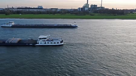 tv tower : Duesseldorf  Germany - April 06 2018 : Transport vessel Elmaro delivering coal on the river Rhine by Duesseldorf Stock Footage