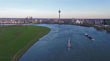tv tower : Duesseldorf  Germany - April 06 2018 : Transport vessel Ariane delivering gravel on the river Rhine by Duesseldorf