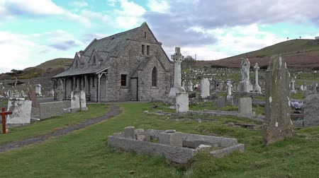 churchyard : Llandudno  Wales, UK - April 22 2018 : St Tudnos church and cemetery on the Great Orme at Llandudno, Wales, UK Stock Footage