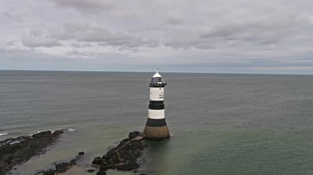 полосатый : Penmon, Anglesey  Wales - April 23 2018: The Penmon point lighthouse is located close to Puffin Island