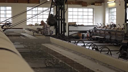 lifler : Trefriw  Wales - April 24 2018 : Historic woolen mill production in Wales - United Kingdom Stok Video