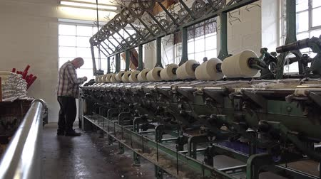 raw materials : Trefriw  Wales - April 24 2018 : Historic woolen mill production in Wales - United Kingdom Stock Footage