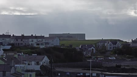 radyoaktif : Cemaes  Wales - April 26 2018 : Cemaes is declared as an area of outstanding natural beauty but with a nuclear power plant Stok Video