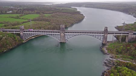 pilon : Anglesey  Wales - April 26 2018 : Robert Stephenson Britannia Bridge carries road and railway across the Menai Straits between, Snowdonia and Anglesey