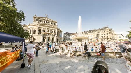 oper : Frankfurt  Germany - August 02 2018: People searching for refreshment in the water of the fountain at Opernplatz during one of the warmest summer days in the city Stock Footage