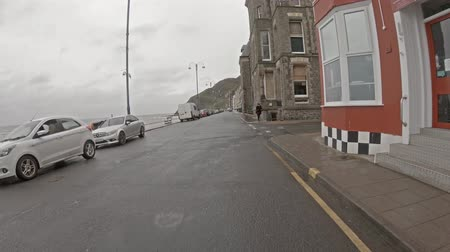 atravessar : Aberystwyth  Wales - May 01 2018 : Driving along the coast of Aberystwyth in west wales in the rain Stock Footage