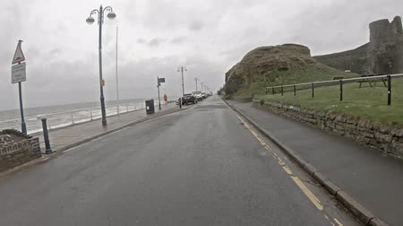 drive through : Aberystwyth  Wales - May 01 2018 : Driving along the coast of Aberystwyth in west wales in the rain Stock Footage