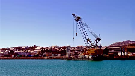 eire : Holyhead  Wales - April 30 2018 : Crane operating at Holyhead harbour close to the ferry terminal to Ireland Stock Footage