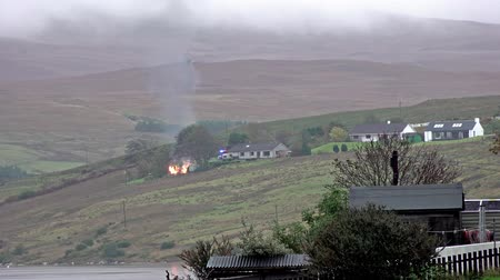 виски : Isle of Skye  Scotland - October 10 2018: Fire is burning next to the distillery