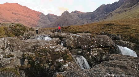 quebradiço : Isle of Skye  Scotland - October 11 2018 : Tourists enjoying the fairy pools Stock Footage