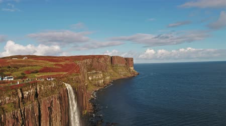Staffing, Isle of Skye  Scotland - October 14 2018: Tourists visiting the dramatic coastline at the cliffs by Staffin with the famous Kilt Rock waterfall