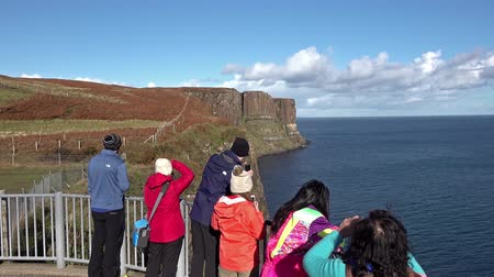 Isle of Skye  Scotland - October 14 2018 : Tourists visiting the Kilt Rock waterfall by Staffin