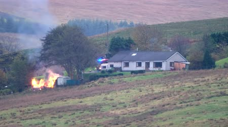 Carbost, Isle of Skye  Scotland - October 15 2018 : Fire fighter exxtinguishing fire in the village