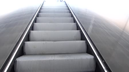 Going up escalator