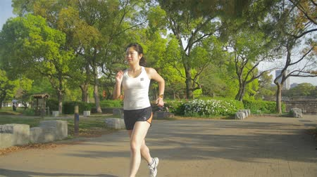 jogging : Japanse female running jogging in the morning Slow motio