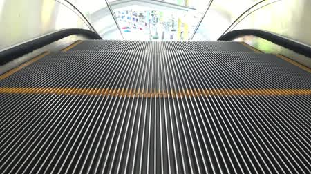enduring : the escalator moving down