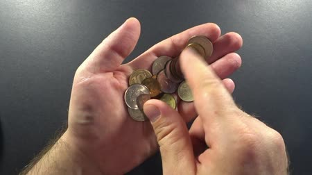 wealth : the person sees the coins on the palm of your hand Stock Footage