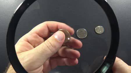 gazete : One euro cent in clip over magnifier lens. Finance concept. Stok Video