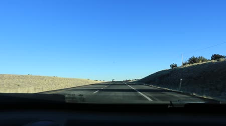 Driving Fast Through the Nevada Desert in Red Rock USA.