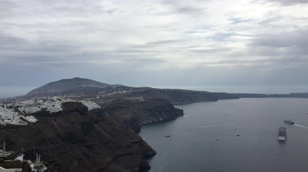 the view of Nea Kameni and Fira from Oia near Santorini, cyclades, Greece Stock mozgókép