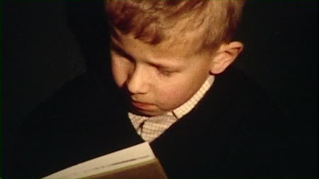 ler : Boy reading a book vintage