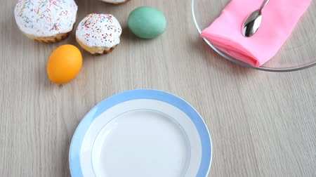 truly : On the festive table alongside with painted eggs appears dish and Easter cake.