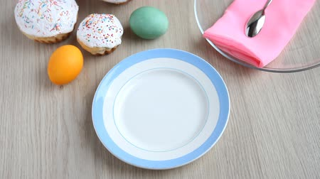 truly : Hands put on the table a plate with a Easter cake with white icing. Stock Footage
