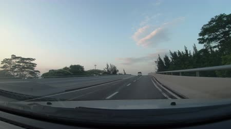 Шэньчжэнь : Driving a Car on a City overpass Road - POV - Point of view front - windshield. Day.