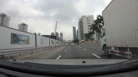 orta hava : SHENZHEN, CHINA - SEPTEMBER 14 2018: Driving a Car on city road ,circa september 14 2018 shenzhen, china.  POV - Point of view front -4k Stok Video