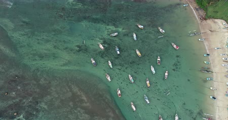 шри : Aerial view of beautiful seascape with fishing boats  in the coast Стоковые видеозаписи