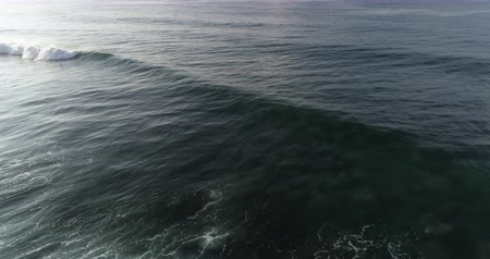Aerial view. Aerial drone footage of ocean waves in the sunrise