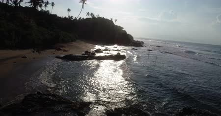 アセント : Aerial view.Drone ascent aerial footage of ocean waves and weligama cap in the sunrise landscape