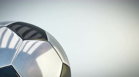 Rotating glossy soccer ball background - seamless looping