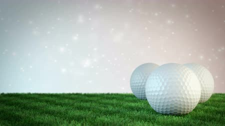 golf balls on grass field with bokeh background - seamless loop