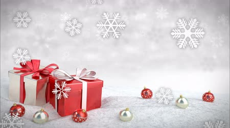 cadeaus : Christmas gift box and balls on snow.3D render. seamless loop Stockvideo