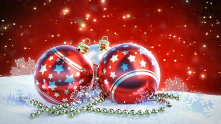 szenteste : red and silver christmas balls on snow with glitter bokeh background. Seamless loop. 3D render