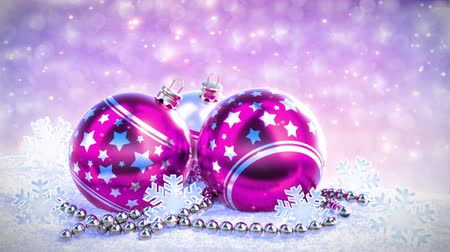 снежинки : purple and silver christmas balls on snow with glitter bokeh background. Seamless loop. 3D render
